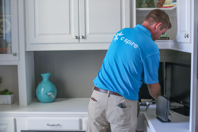 A C Spire Home technician installs fiber-based, ultra-fast Gigabit internet in a home. The company is accepting customer pre-orders for service in Helena and Pelham, Alabama now and in Alabaster, Alabama soon.